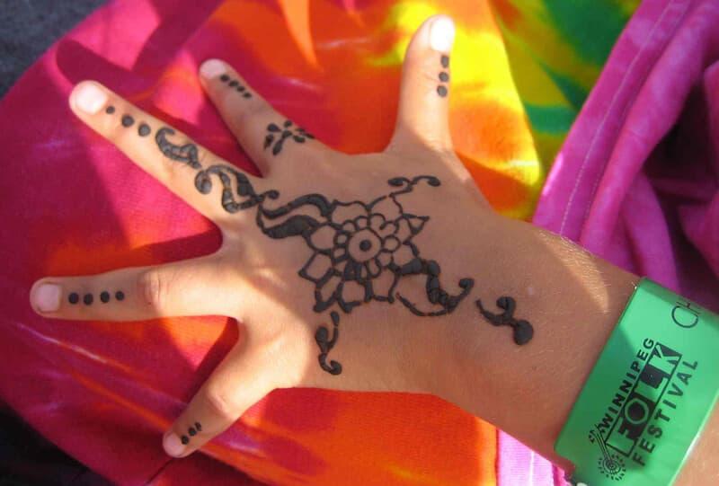 henna tattoo on hand at festival