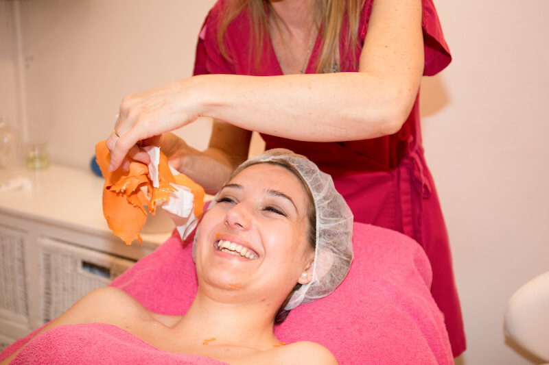 lady having chemical peel mask removed