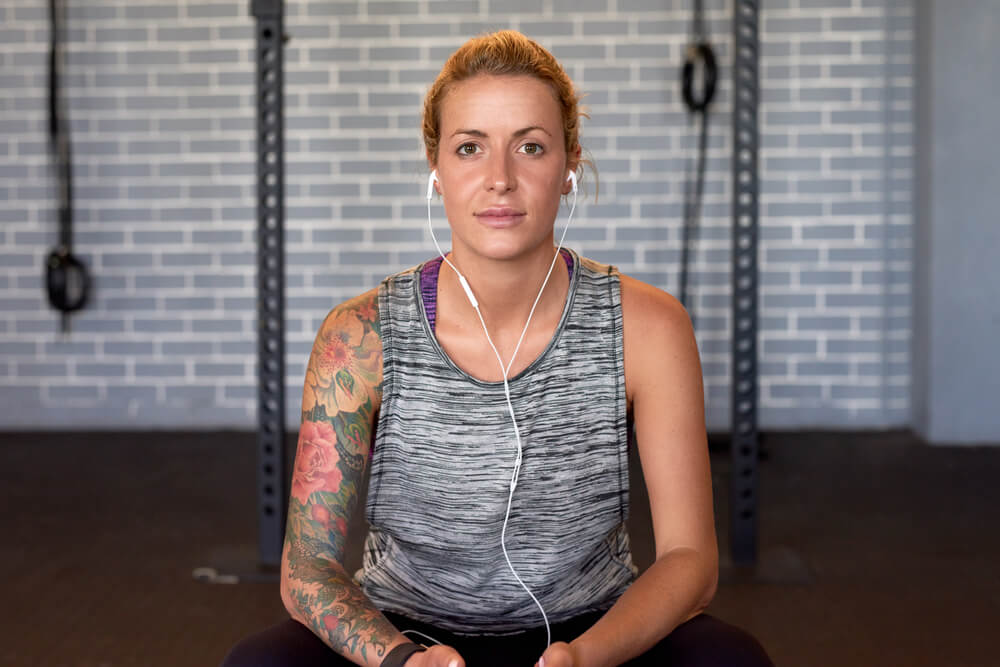 lady with tattoos in gym