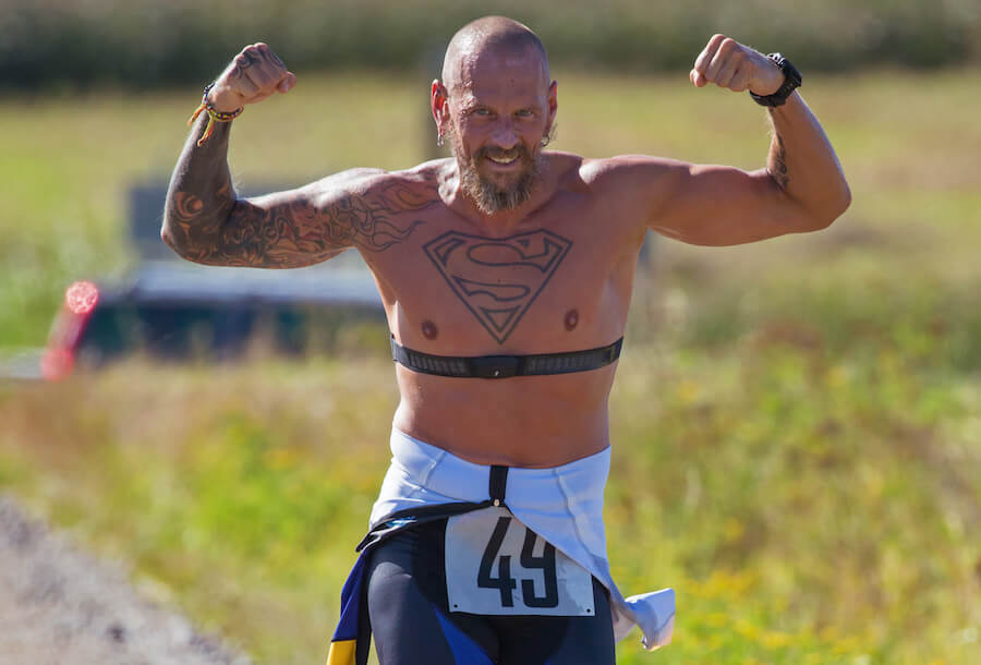 man with tattoo superman running