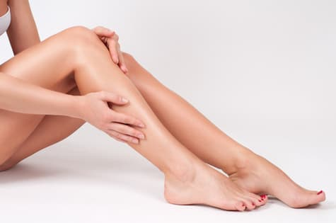 smooth hairless legs of woman